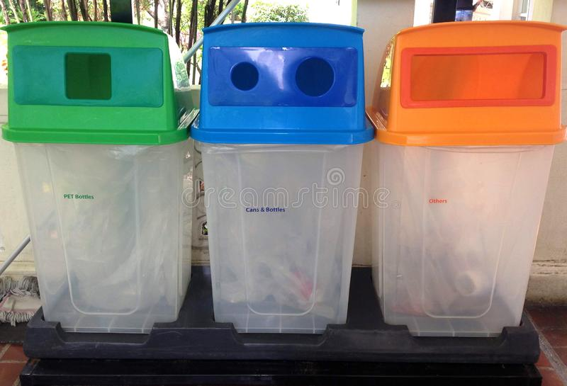 Multi colored green, blue, orange trash bins. Trash for cleanliness recycling concept royalty free stock photography