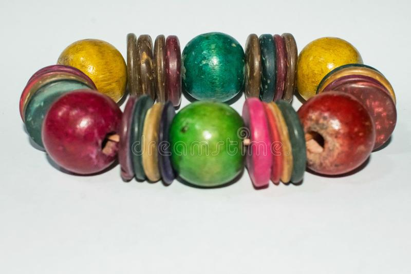 Multi-colored handmade wood bracelet isolated on white background stock images