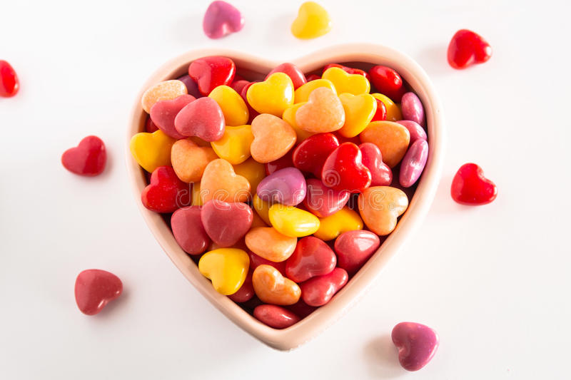 Multi Colored Heart Shaped Valentines Day Candy In Ceramic Bowl stock photos