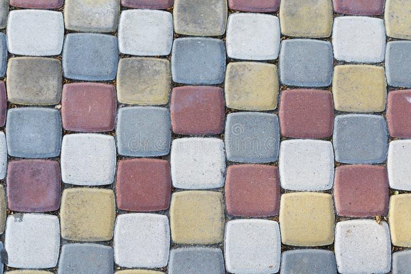 Multi-colored het bedekken plakken in de vorm van bakstenen stock foto