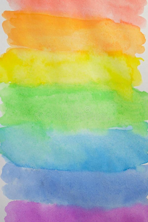 Multi colored horizontal stripes painted with rainbow watercolor. stock images