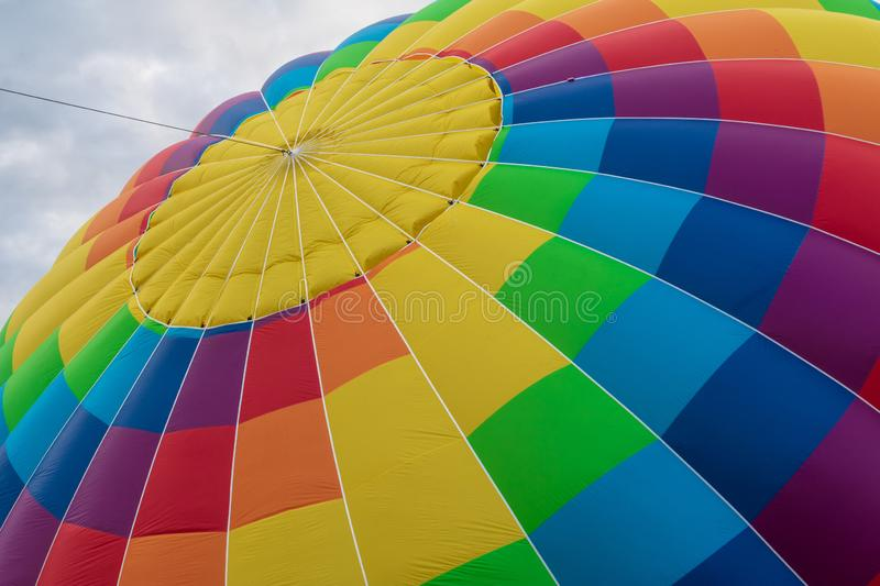 Angled view of the top of a colorful hot air balloon royalty free stock images