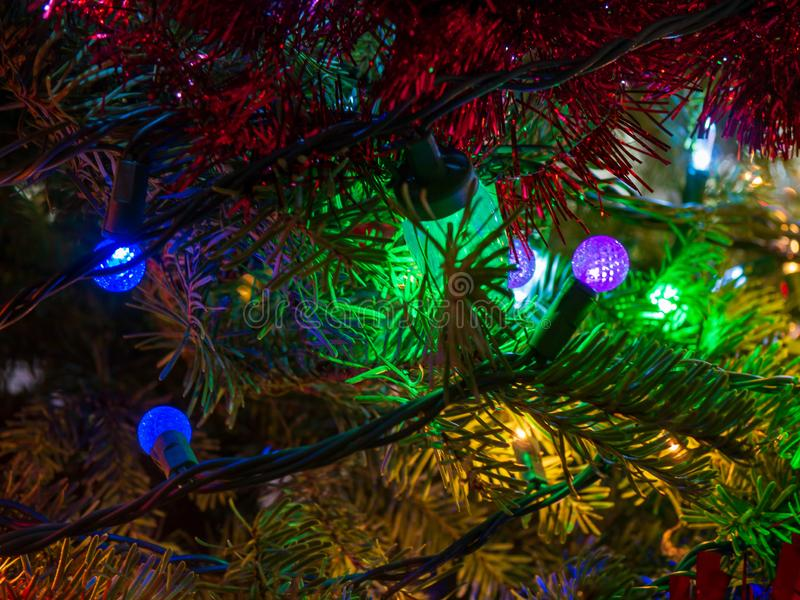 Multi colored ight on christmas tree macro detail shot stock photography