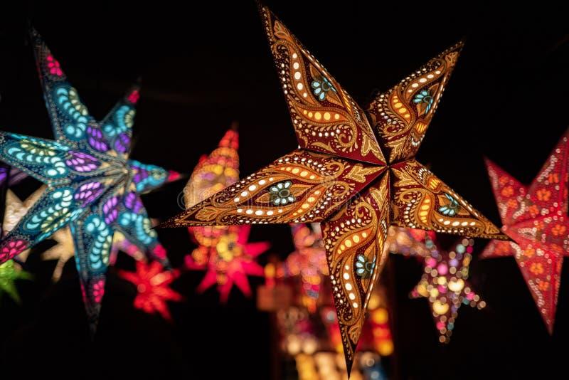 Multi colored illuminated Christmas stars royalty free stock photos