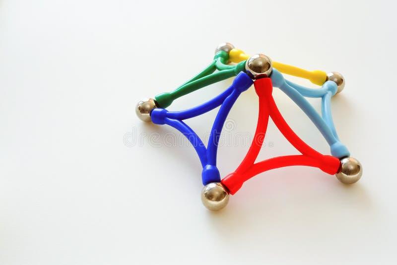 Multi-colored kinderen` s plastic magnetische ontwerper stock foto