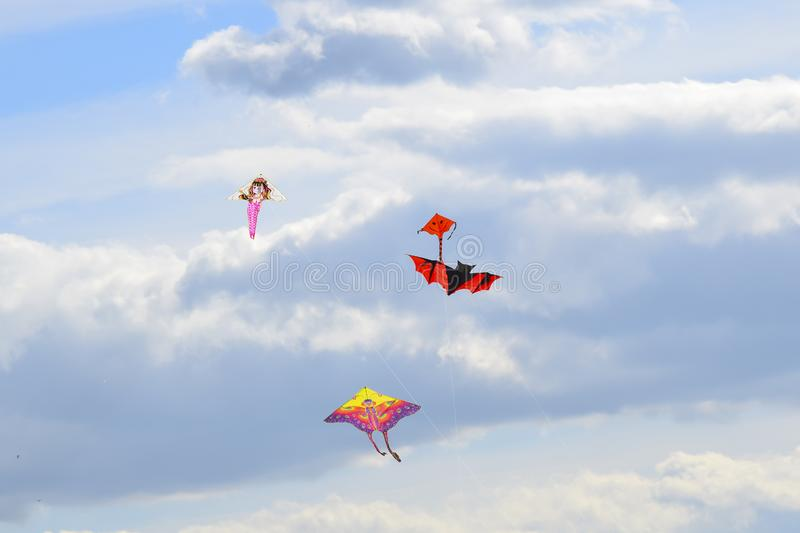 multi colored kites in the blue sky royalty free stock photography