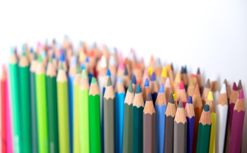 Multi-colored kleuringspotloden met exemplaarruimte stock afbeelding