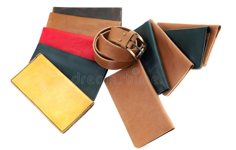 Multi-colored leather wallets and a belt. leather accessories an royalty free stock photo