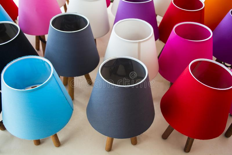 Multi colored lit lampshades in a store royalty free stock image