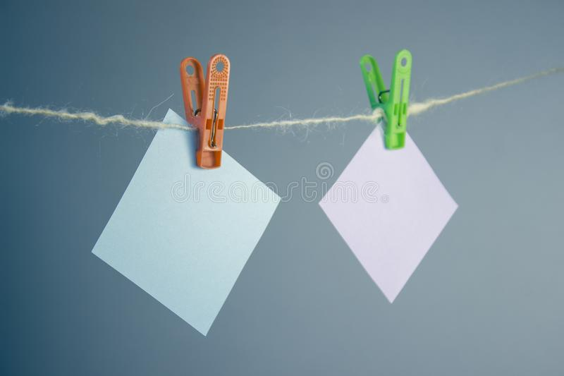 Multicolored notes hung on the clothesline. royalty free stock photography