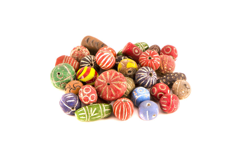 Multi colored old ceramic indian beads isolated on white royalty free stock photography