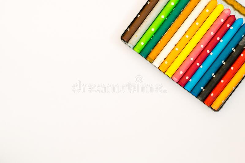 Multi Colored Pencils over White Background stock image