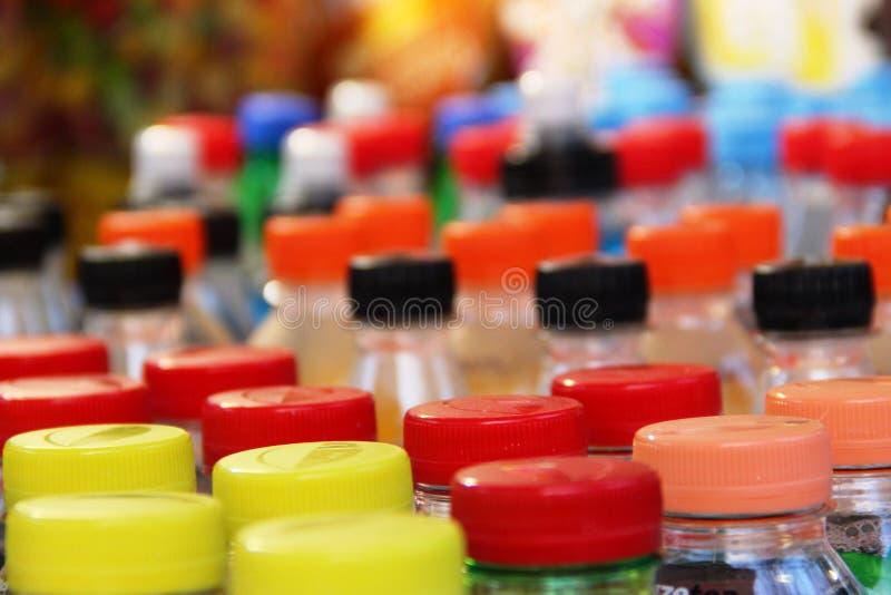Multi-colored plastic bottle caps. plastic bottle caps varicolored. Multi-colored plastic bottle caps, close-up. plastic bottle caps varicolored, selective focus royalty free stock images