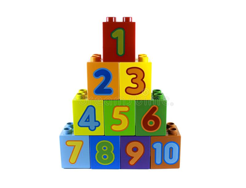 Multi-colored plastic constructor with numbers 1, 2, 3 ... and 10 are located in a pyramid. The development of young children. Whi stock images