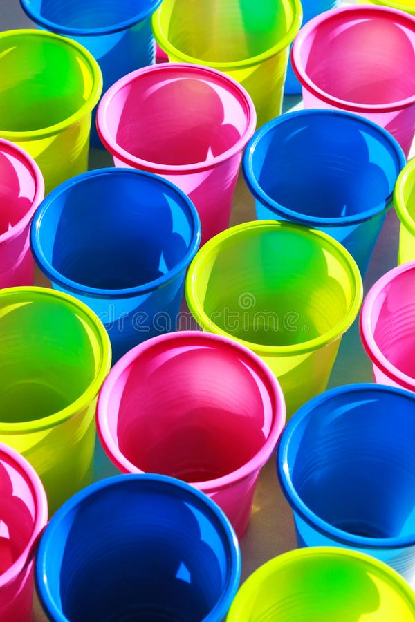 Multi colored plastic cups, full frame. Close-up of rows of multi colored plastic cups, full frame stock photography