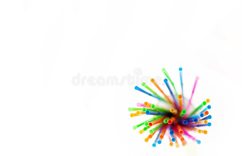 Multi-colored plastic straws on white background stock images