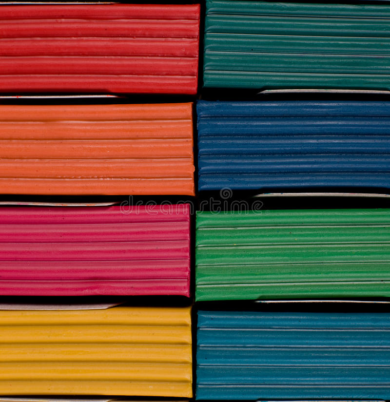 Multi colored plasticine in box. Close up of multi coloredplasticine in box stock photography