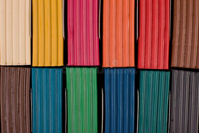 Multi colored plasticine in box. Close up of multi coloredplasticine in box royalty free stock photography