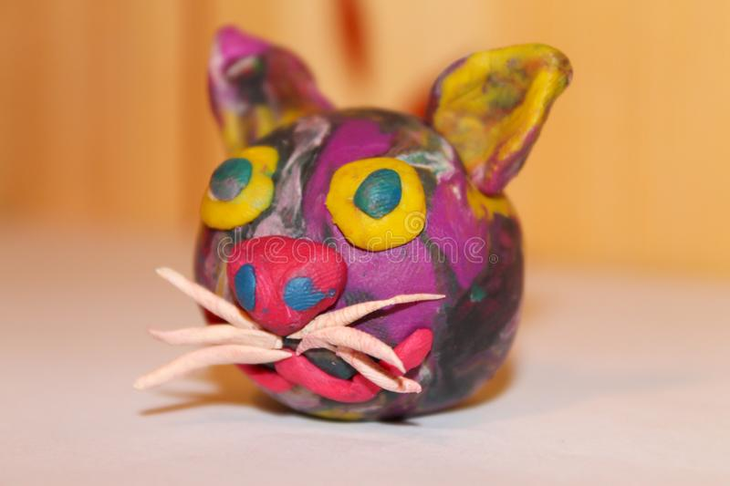 Plasticine cat head close-up. creativity and design royalty free stock photography