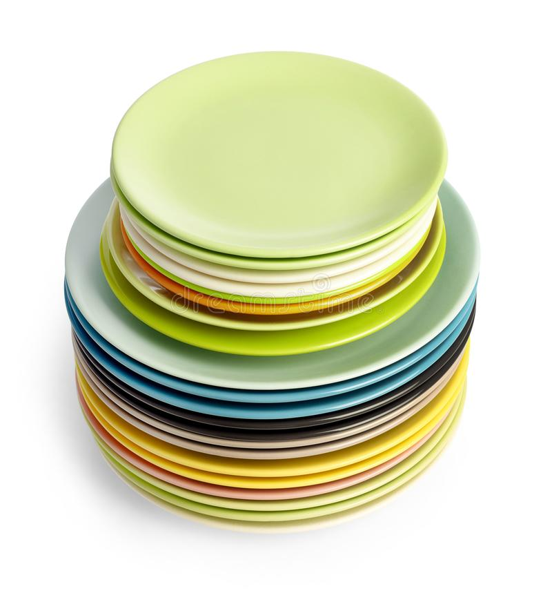Multi-colored plates on white royalty free stock photos