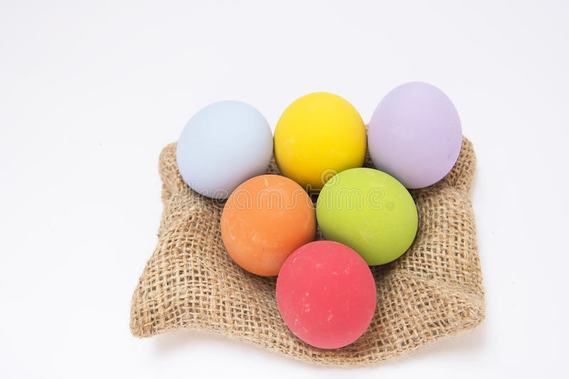 Multi-colored preserved egg sacks on. Preserved egg on white background background with copy space stock photography