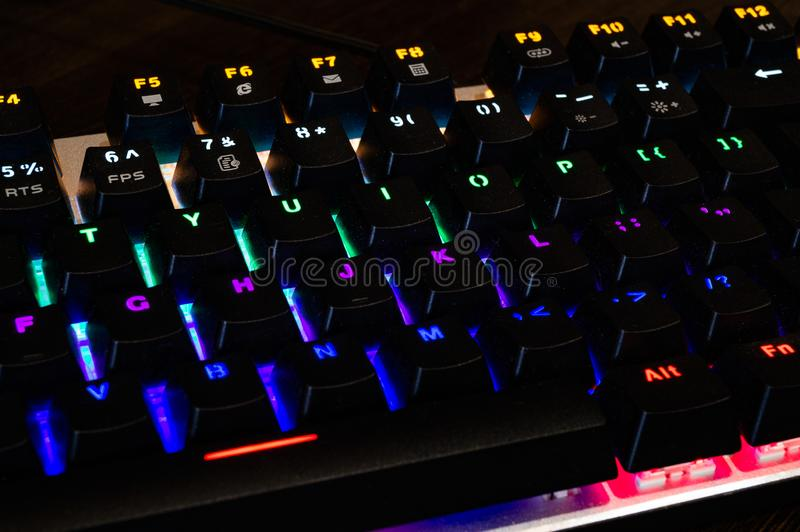Multi-colored professional gaming mechanical rgb keyboard on the table stock photography