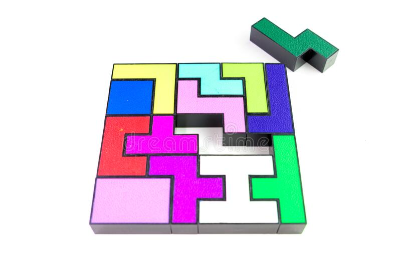 Multi-colored puzzle made of plastic blocks, that`s missing one piece, isolated on white background. Multi-colored puzzle made of plastic blocks, that`s missing royalty free stock image