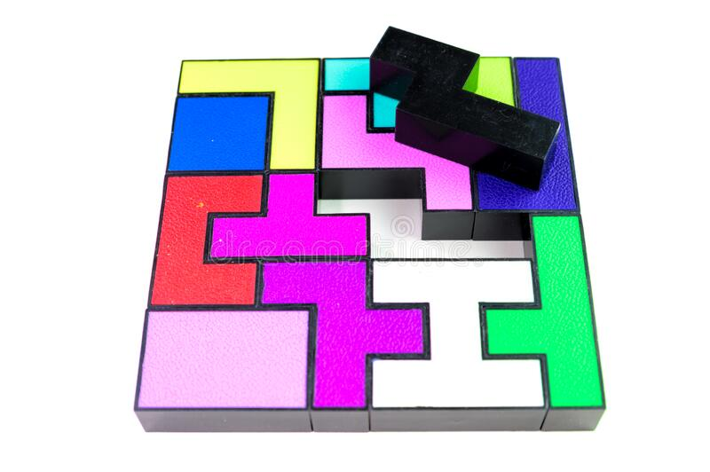 Multi-colored puzzle made of plastic blocks, that`s missing one piece, isolated on white background. Multi-colored puzzle made of plastic blocks, that`s missing stock images