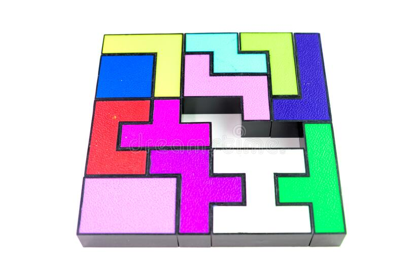 Multi-colored puzzle made of plastic blocks, that`s missing one piece, isolated on white background. Multi-colored puzzle made of plastic blocks, that`s missing royalty free stock photos