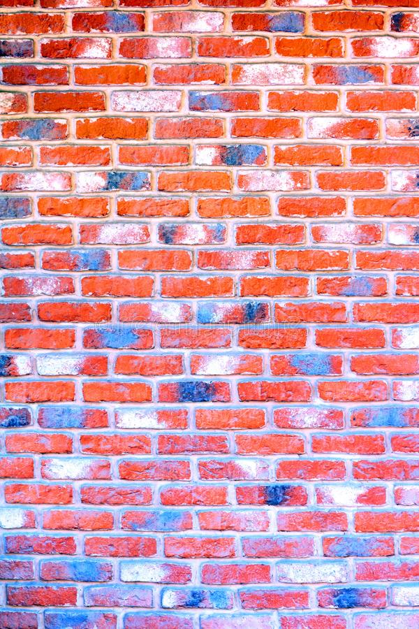 Multi-colored red brick wall. stock photography