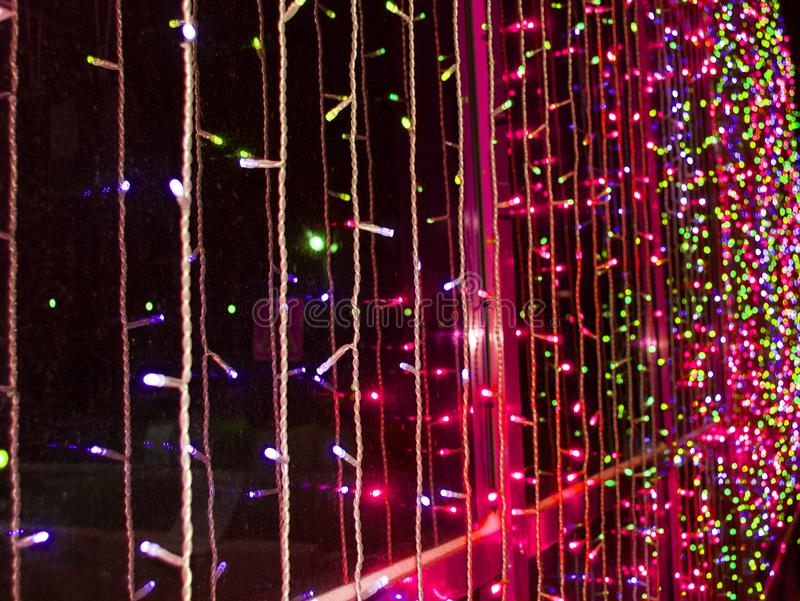 Multi-colored and red led lights on the building during the holiday, night, outdoor royalty free stock photo