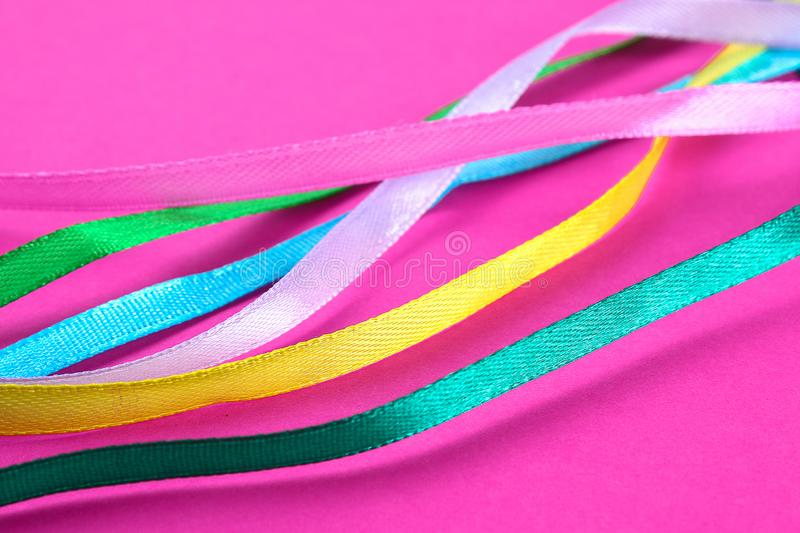 Multi-colored ribbons for sewing and needlework from fabric royalty free stock photos