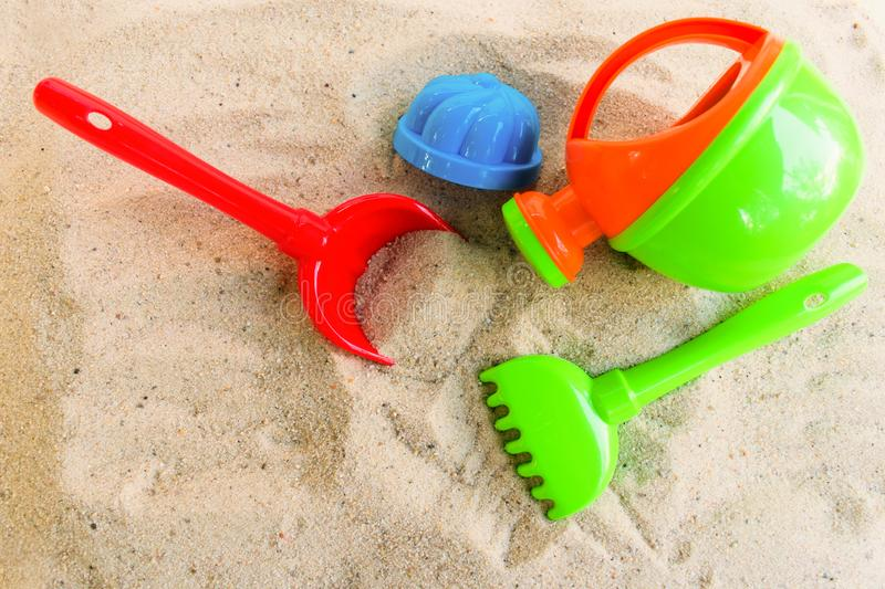 A multi-colored set of children`s toys for the summer games in the sandbox or on the sandy beach. The concept of  holidays stock photo