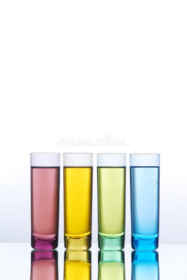 Multi-colored shot glasses stock photo