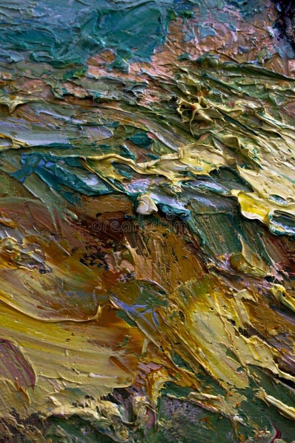Multi-colored slagen van olieverf op het palet van de kunstenaar Achtergrond royalty-vrije stock afbeelding