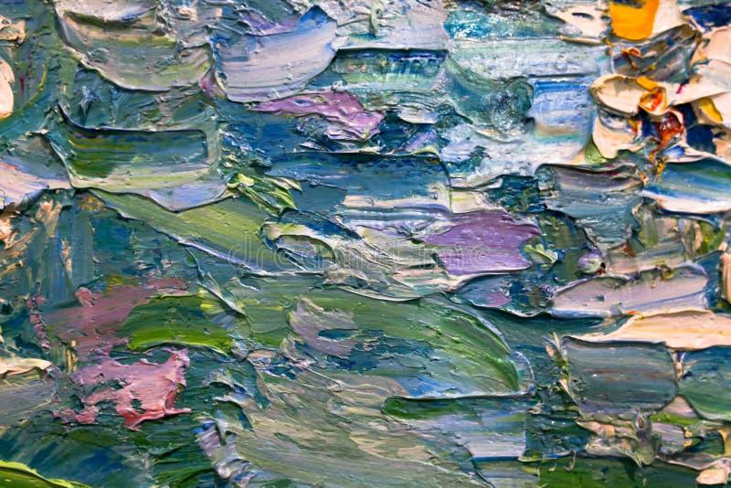 Multi-colored slagen van olieverf op het palet van de kunstenaar Achtergrond royalty-vrije stock afbeeldingen