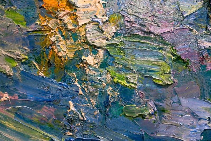 Multi-colored slagen van olieverf op het palet van de kunstenaar Achtergrond royalty-vrije stock foto's
