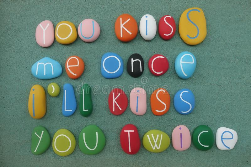 You kiss me once, I`ll kiss you twice stock image