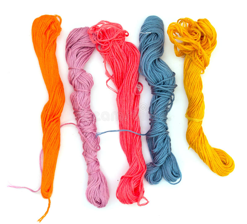 Multi-colored threads of a mouline thread royalty free stock image