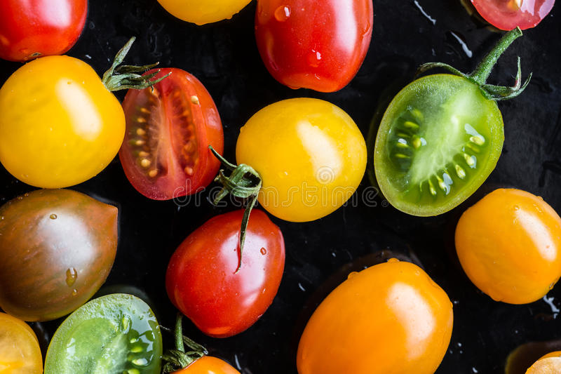 Multi-colored tomatoes stock photo