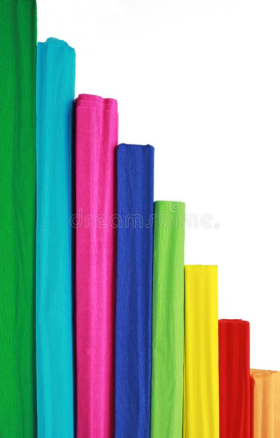 Multi colored vertical pattern with crepe paper rolls. In front of a white background royalty free stock images