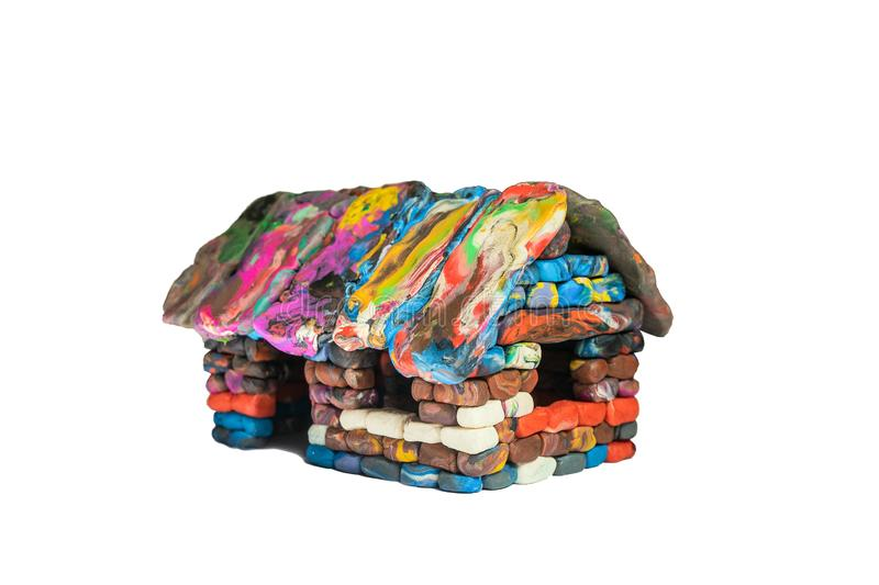 Multi-colored voluminous plasticine house from small piece block elements stock photos