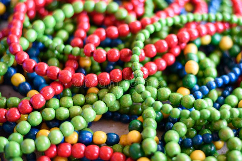 Multi-colored wooden beads. Directly above. Close up royalty free stock photos