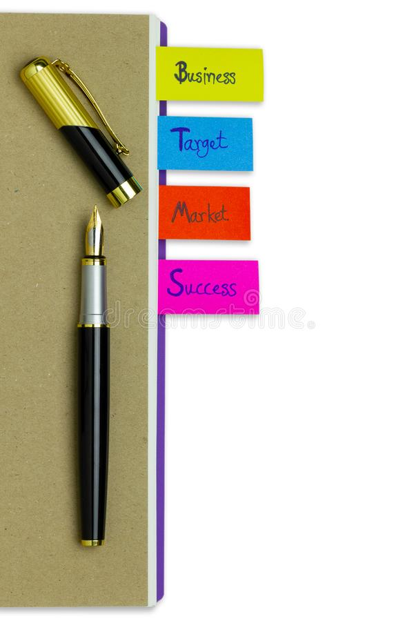Multi colour bookmark in business notebook and a pen. stock images