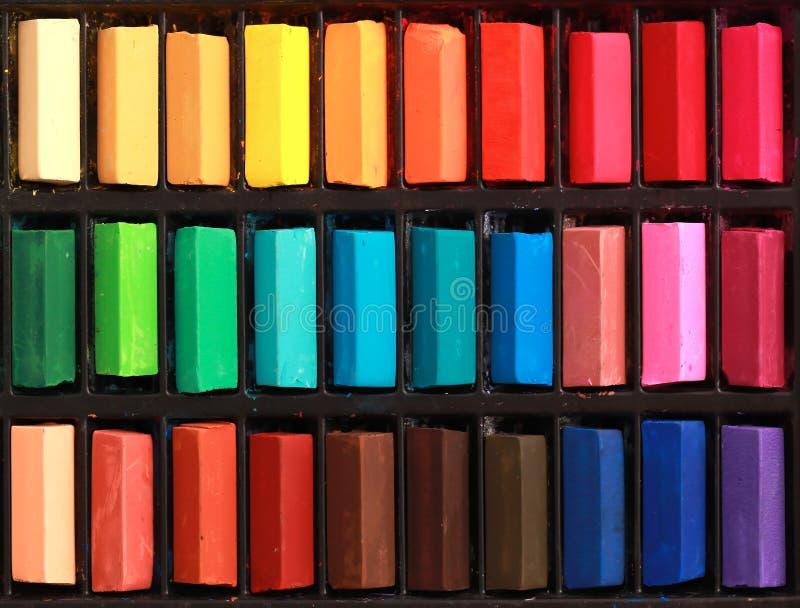 Pastel background. Multi colour pastel chalks background stock photos
