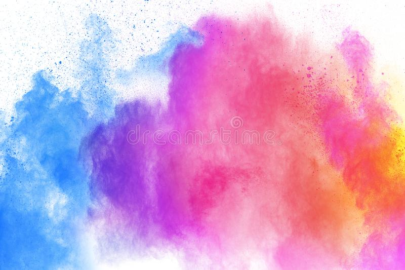 Multi colour powder explosion on white background. Launched colourful dust particles splashing royalty free stock photo