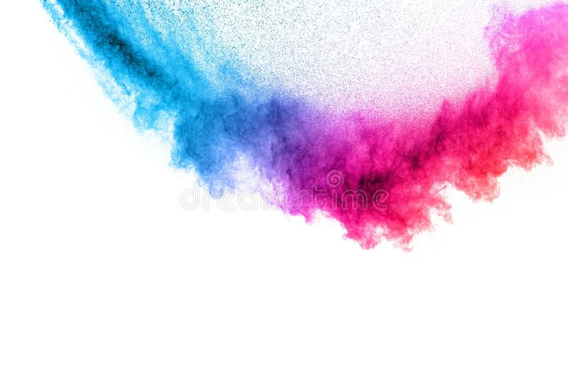 Multi colour powder explosion on white background. Launched colourful dust particles splashing royalty free stock photos