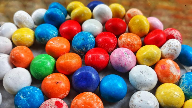 The Multi Coloured Candy Bean. Assorted, blue, bright, celebration, chewy, childhood, chocolate, color, colorful, confection, confectionary, confectionery royalty free stock photography