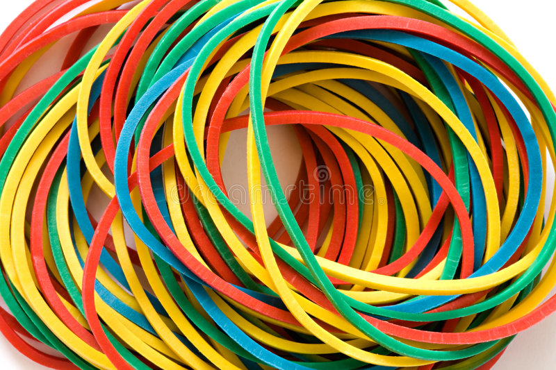 Multi-coloured elastic bands. Set of multi-coloured elastic bands close up stock photos