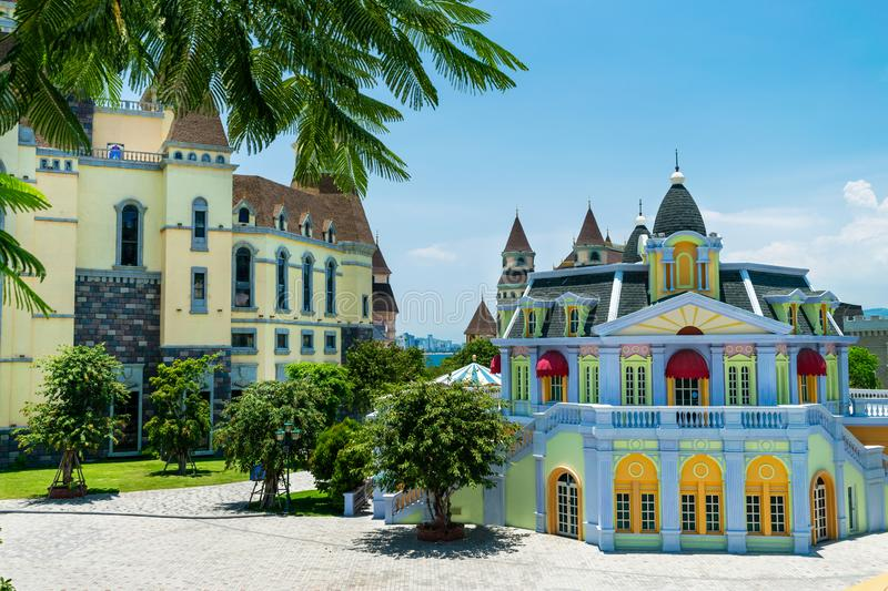 A multi-coloured fairy castle in a tropical climate with palm on sunny day. A multi-coloured fairy castle in a tropical climate with palm at sunny day, island royalty free stock images